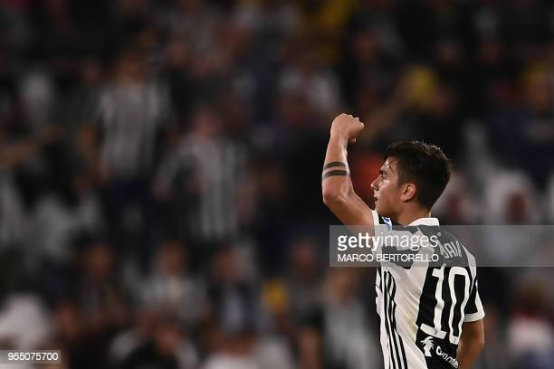 Juventus' forward Paulo Dybala from Argentina celebrates after scoring a goal during the Italian Serie A football match between Juventus and Bologna...