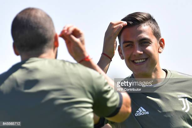 Juventus' forward Paulo Dybala from Argentina takes part in a training session on the eve of the UEFA Champions League football match Barcelona vs...