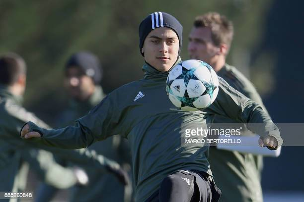 Juventus' forward Paulo Dybala from Argentina takes part in a training session on the eve of the UEFA Champions League football match Olympiacos Vs...