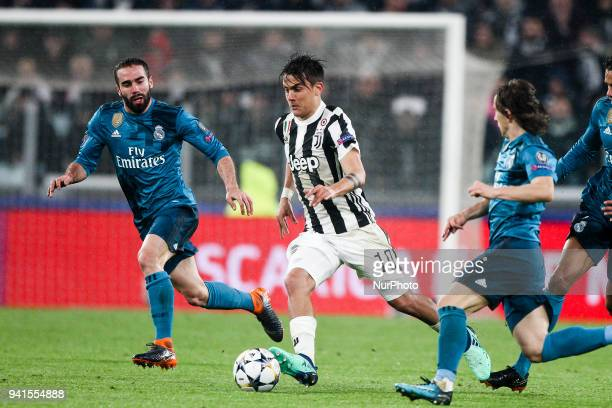 Juventus forward Paulo Dybala in action during the Uefa Champions League Round of 16 football match JUVENTUS REAL MADRID on at the Allianz Stadium in...