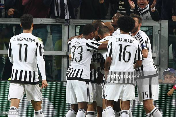 Juventus forward Simone Zaza celebrates with his teammates after scoring his goal during the Uefa Champions League group stage football match n2...