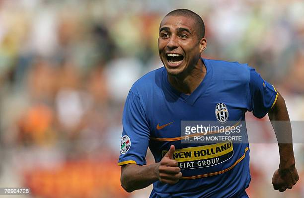 Juventus' French forward David Trezeguet jubilates after scoring against AS Roma during their Serie A football match at Rome's Olympic Stadium 23...