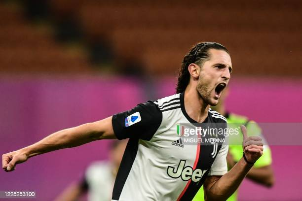 Juventus' French midfielder Adrien Rabiot celebrates after opening the scoring during the Italian Serie A football match AC Milan vs Juventus played...