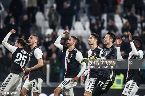 TOPSHOT Juventus' French midfielder Adrien Rabiot Juventus' Turkish defender Merih Demiral Juventus' Uruguayan midfielder Rodrigo Bentancur Juventus'...