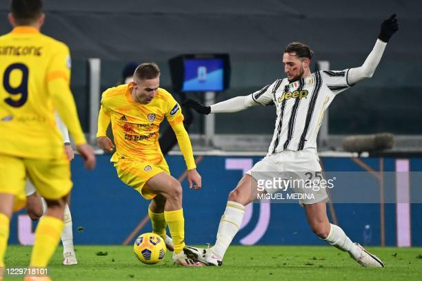 Juventus' French midfielder Adrien Rabiot tackles Cagliari's Croatian midfielder Marko Rog during the Italian Serie A football match Juventus vs...