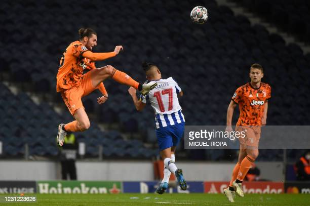 """Juventus' French midfielder Adrien Rabiot vies with FC Porto's Mexican forward Jesus Corona """"Tecatito"""" during the UEFA Champions League round of 16..."""