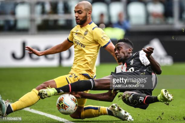 TOPSHOT Juventus' French midfielder Blaise Matuidi and Verona's Moroccan midfielder Sofyan Amrabat go for the ball during the Italian Serie A...