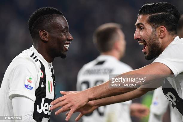 Juventus' French midfielder Blaise Matuidi celebrates with Juventus' German midfielder Emre Can after scoring a header during the Italian Serie A...