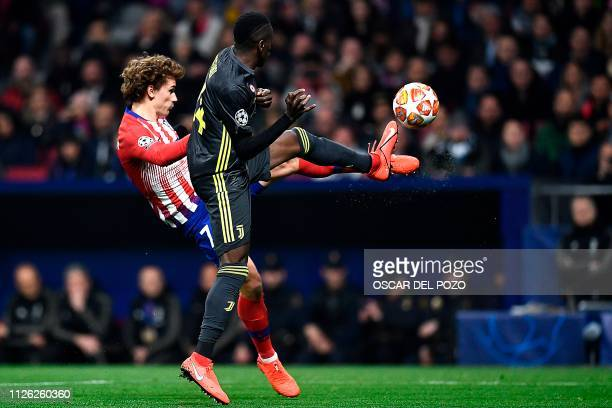 Juventus' French midfielder Blaise Matuidi challenges Atletico Madrid's French forward Antoine Griezmann during the UEFA Champions League round of 16...