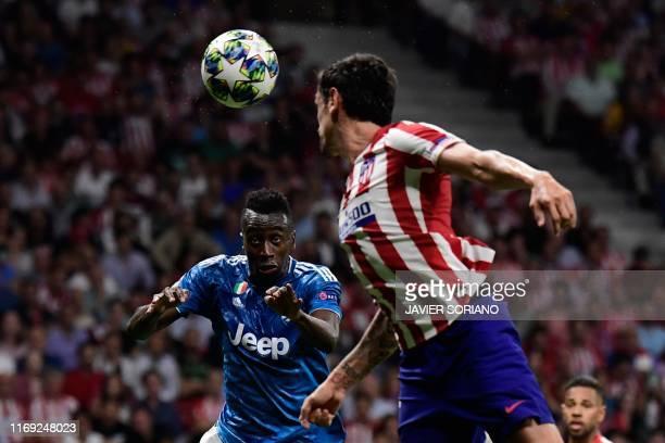 Juventus' French midfielder Blaise Matuidi challkenges Atletico Madrid's Montenegrin defender Stefan Savic during the UEFA Champions League Group D...