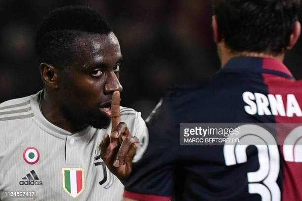 Juventus' French midfielder Blaise Matuidi gestures as he talks to Cagliari's Croatian defender Darijo Srna during the Italian Serie A football march...