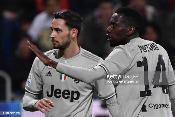 Juventus' French midfielder Blaise Matuidi gestures towards towards Cagliari's fans who threw projectiles and bottles after Juventus' Italian forward...