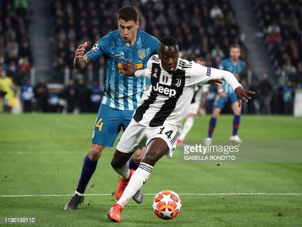 Juventus' French midfielder Blaise Matuidi holds off Atletico Madrid's Uruguayan defender Jose Gimenez during the UEFA Champions League round of 16...