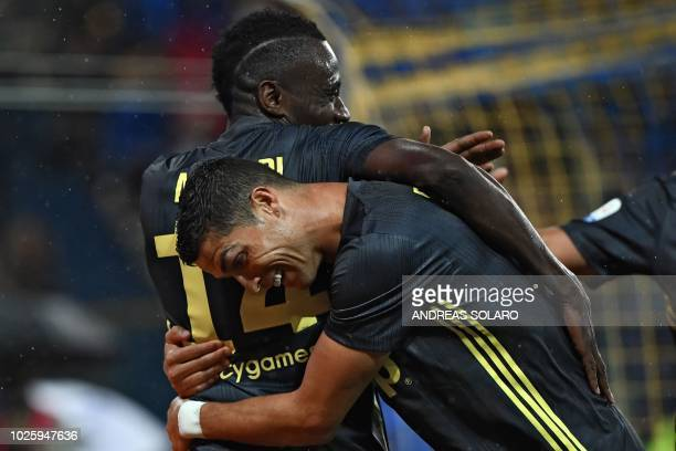 Juventus' French midfielder Blaise Matuidi is congratulated by Juventus' Portuguese forward Cristiano Ronaldo after scoring a goal during the Italian...