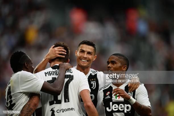 Juventus' French midfielder Blaise Matuidi Juventus' Croatian forward Mario Mandzukic Juventus' Portuguese forward Cristiano Ronaldo and Juventus'...