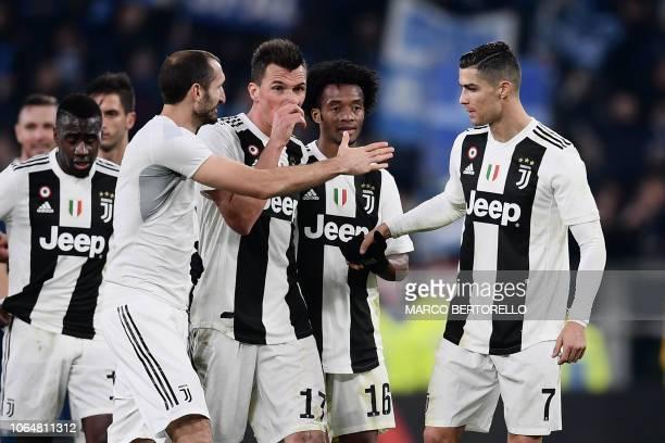 Juventus' French midfielder Blaise Matuidi Juventus' Italian defender Giorgio Chiellini Juventus' Croatian forward Mario Mandzukic Juventus'...
