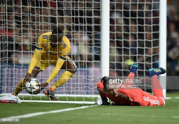 Juventus' French midfielder Blaise Matuidi picks up the ball after Juventus' Croatian forward Mario Mandzukic scored against Real Madrid's Costa...
