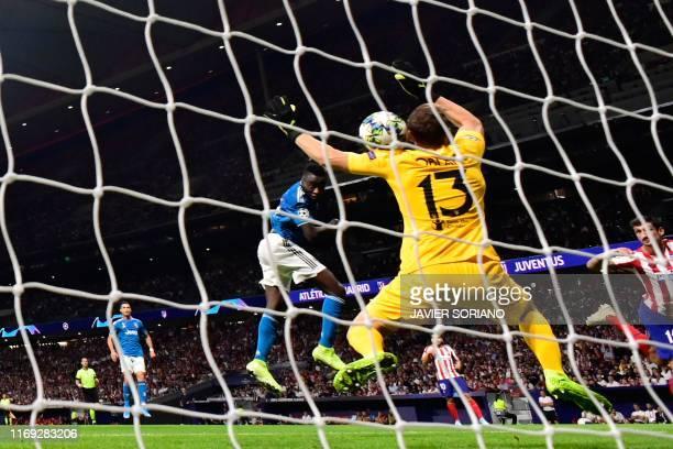 Juventus' French midfielder Blaise Matuidi scores against Atletico Madrid's Slovenian goalkeeper Jan Oblak during the UEFA Champions League Group D...