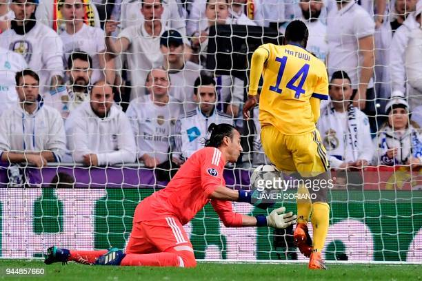 Juventus' French midfielder Blaise Matuidi scores against Real Madrid's Costa Rican goalkeeper Keylor Navas during the UEFA Champions League...