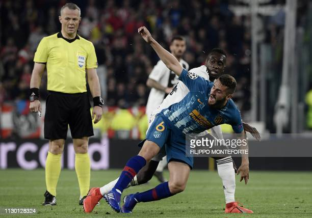 Juventus' French midfielder Blaise Matuidi tackles Atletico Madrid's Spanish midfielder Koke during the UEFA Champions League round of 16 secondleg...