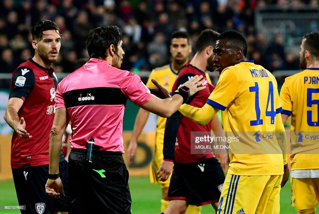 Juventus' French midfielder Blaise Matuidi (R) talks with Italian referee Gianpaolo Calvarese during the Italian Serie A football match between Cagliari Calcio and Juventus at the Sardegna Arena stadium in Cagliari, on the Mediterranean island of Sardinia, on January 6, 2018. Matuidi has hit out after he suffered racist abuse during the Serie A game on January 6 against Cagliari in Sardinia and was ignored when he asked the referee to intervene. /