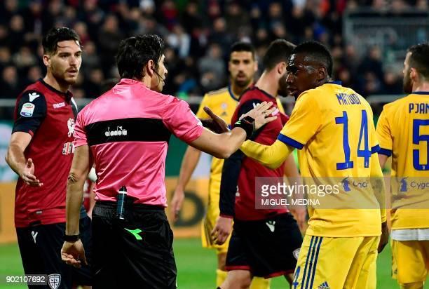 Juventus' French midfielder Blaise Matuidi talks with Italian referee Gianpaolo Calvarese during the Italian Serie A football match between Cagliari...