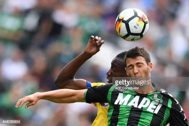 Juventus' French midfielder Blaise Matuidi vies for the ball with Sassuolo's Italian midfielder Luca Mazzitelli during the Italian Serie A football...