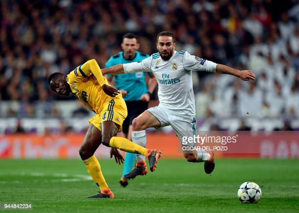 Juventus' French midfielder Blaise Matuidi vies with Real Madrid's Spanish defender Dani Carvajal during the UEFA Champions League quarterfinal...