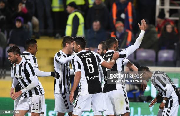 Juventus' FrenchArgentinian forward Gonzalo Higuain celebrates with teammates after scoring during the italian Serie A football match Fiorentina vs...