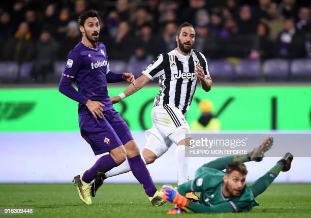 Juventus' FrenchArgentinian forward Gonzalo Higuain scores during the italian Serie A football match Fiorentina vs Juventus at the Atemio Franchi...