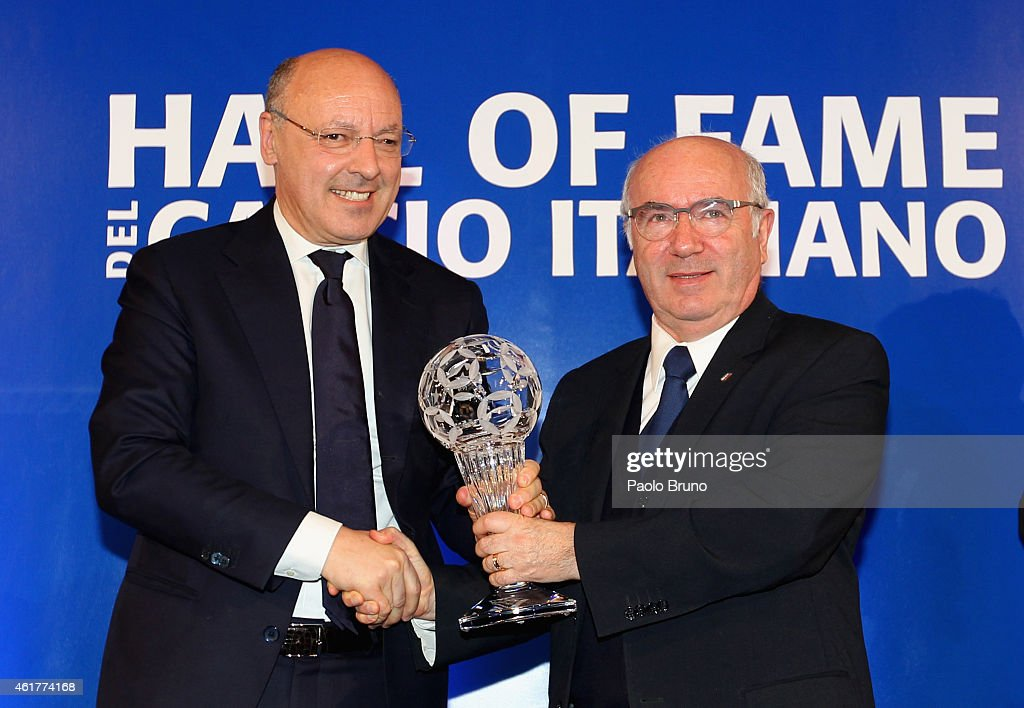 Juventus General Director Giuseppe Marotta and Italian Federation President Carlo Tavecchio pose showing the award during the Italian Football Federation Hall of Fame Award ceremony at Palazzo Vecchio on January 19, 2015 in Florence, Italy.