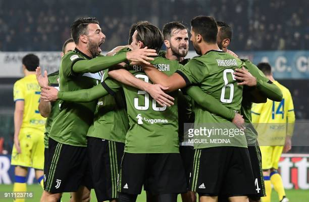 Juventus' Germain midfielder Sami Khedira is congratulated by teammates after scoring a goal during the Italian Serie A football match AC Chievo vs...