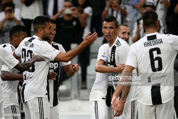Juventus' German midfielder Emre Can and teammates celebrate after Juventus' Croatian forward Mario Mandzukic scored during the Italian Serie A...