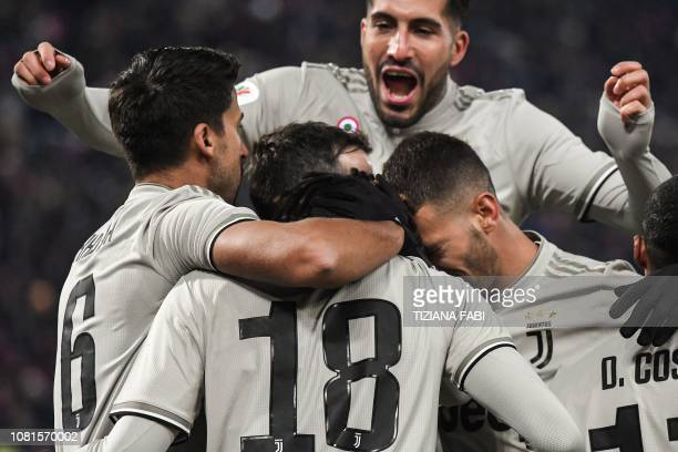 Juventus' German midfielder Emre Can and teammates celebrate after Juventus' Italian forward Moise Kean scored during the Italian Tim Cup round of...