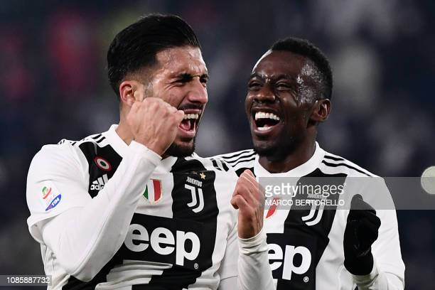 Juventus' German midfielder Emre Can celebrates with Juventus' French midfielder Blaise Matuidi after scoring during the Italian Serie A football...