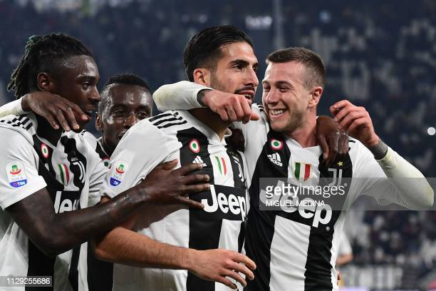 Juventus' German midfielder Emre Can celebrates with Juventus' Italian forward Moise Kean Juventus' French midfielder Blaise Matuidi and Juventus'...