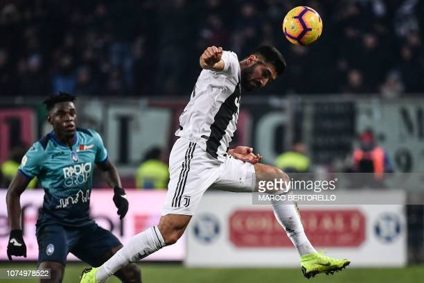 Juventus' German midfielder Emre Can heads the ball ahead of Atalanta's Colombian forward Duvan Zapata during the Italian Serie A football Match...