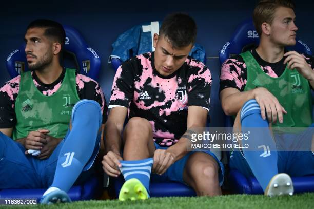 Juventus' German midfielder Emre Can Juventus' Argentine forward Paulo Dybala and Juventus' Dutch defender Matthijs de Ligt sit on the substitutes'...