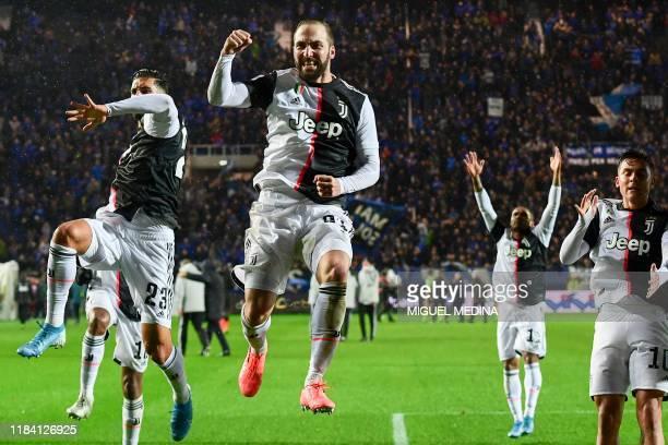 Juventus' German midfielder Emre Can, Juventus' Argentinian forward Gonzalo Higuain and Juventus' Argentine forward Paulo Dybala acknowledge the...