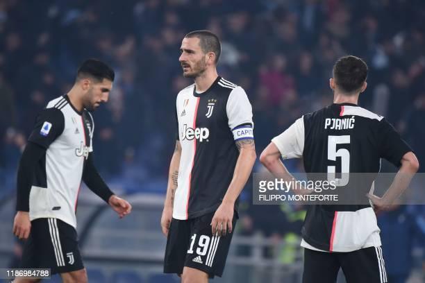Juventus' German midfielder Emre Can Juventus' Italian defender Leonardo Bonucci and Juventus' Bosnian midfielder Miralem Pjanic react at the end of...