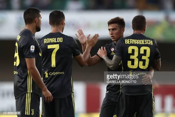 Juventus' German midfielder Emre Can Juventus' Portuguese forward Cristiano Ronaldo Juventus' Argentinian forward Paulo Dybala and Juventus' forward...