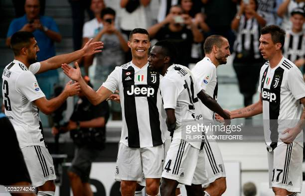 Juventus' German midfielder Emre Can Juventus' Portuguese forward Cristiano Ronaldo Juventus' French midfielder Blaise Matuidi Juventus' Italian...