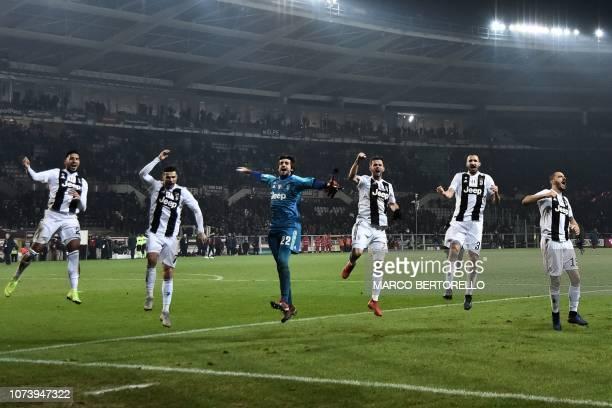 TOPSHOT Juventus' German midfielder Emre Can Juventus' Portuguese forward Cristiano Ronaldo Juventus' Italian goalkeeper Mattia Perin Juventus'...