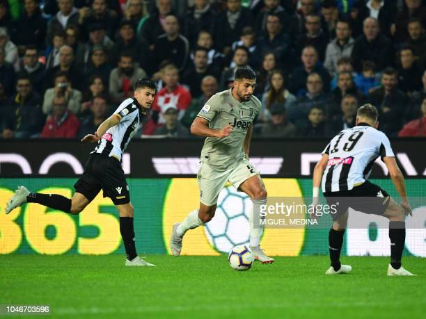 Juventus' German midfielder Emre Can runs with the ball next to Udinese's Argentine forward Ignacio Pussetto and Dutch defender Hidde Ter Avest...