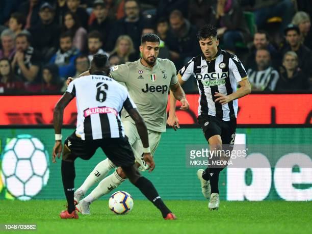Juventus' German midfielder Emre Can runs with the ball next to Udinese's Ivorian midfielder Seko Fofana and Argentine forward Ignacio Pussetto...