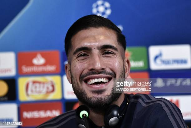 Juventus' German midfielder Emre Can smiles during a press conference on April 15 2019 at the Juventus stadium in Torino on the eve of their UEFA...