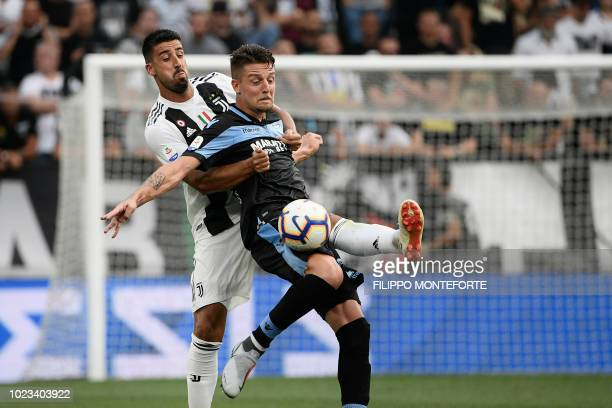 Juventus' German midfielder Sami Khedira and Lazio's Serbian midfielder Sergej MilinkovicSavic go for the ball during the Italian Serie A football...