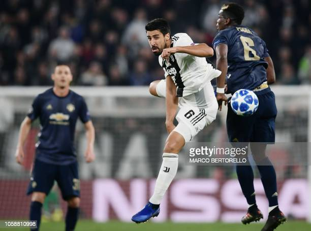 Juventus' German midfielder Sami Khedira and Manchester United's French midfielder Paul Pogba go for the ball during the UEFA Champions League group...