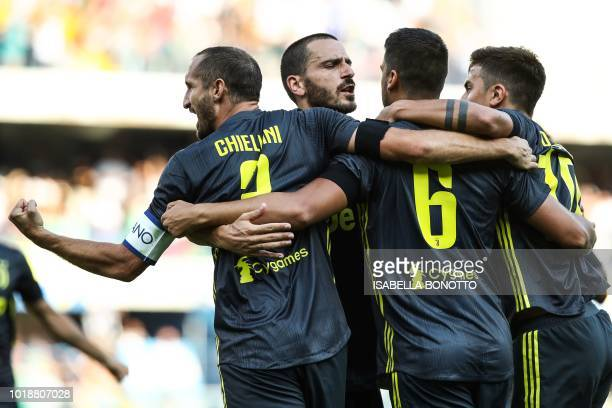 TOPSHOT Juventus' German midfielder Sami Khedira celebrates with Argentinian forward Paulo Dybala and defenders Giorgio Chiellini qnd Leonardo...