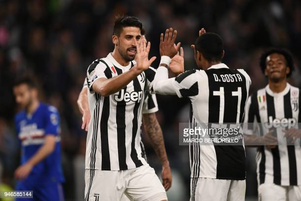 Juventus' German midfielder Sami Khedira celebrates with teammate Juventus' Brazilian midfielder Douglas Costa during the Italian Serie A football...